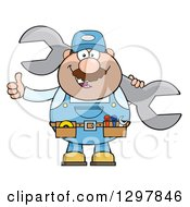 Clipart Of A Cartoon White Male Mechanic Wearing A Tool Belt Giving A Thumb Up And Holding A Giant Wrench Royalty Free Vector Illustration