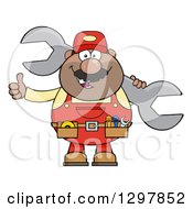 Clipart Of A Cartoon Black Or Hispanic Male Mechanic Wearing A Tool Belt Giving A Thumb Up And Holding A Giant Wrench Royalty Free Vector Illustration