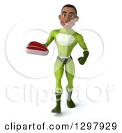 Clipart Of A 3d Young Black Male Super Hero In A Green Suit Walking With A Beef Steak Royalty Free Illustration