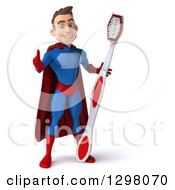 Clipart Of A 3d Young Brunette White Male Super Hero Dentist In A Blue And Red Suit Giving A Thumb Up And Holding A Giant Toothbrush Royalty Free Illustration