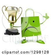 Clipart Of A 3d Unhappy Green Shopping Or Gift Bag Character Holding Up A Finger And A Trophy Royalty Free Illustration