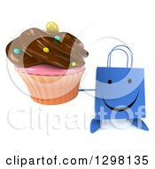 Clipart Of A 3d Happy Blue Shopping Or Gift Bag Character Holding Up A Chocolate Frosted Cupcake Royalty Free Illustration