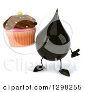 Clipart Of A 3d Oil Drop Character Shrugging And Holding A Chocolate Frosted Cupcake Royalty Free Illustration