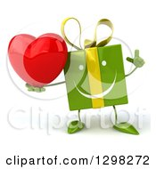 Clipart Of A 3d Green Gift Character Holding Up A Finger And A Heart Royalty Free Illustration