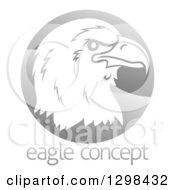 Clipart Of A Profiled Bald Eagle Or Falcon Head On A Shiny Gray Circle Above Sample Text Royalty Free Vector Illustration