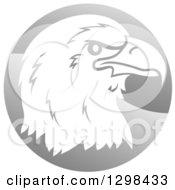 Profiled Bald Eagle Or Falcon Head On A Shiny Gray Circle
