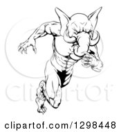 Clipart Of A Black And White Muscular Aggressive Elephant Man Mascot Running Upright Royalty Free Vector Illustration