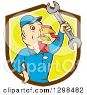 Clipart Of A Cartoon Turkey Bird Worker Mechanic Man Holding Up A Wrench In A Brown White And Yellow Shield Royalty Free Vector Illustration