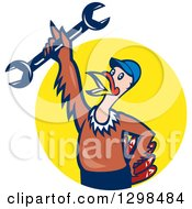 Clipart Of A Cartoon Turkey Bird Worker Mechanic Man Holding Up A Wrench And Emerging From A Yellow Circle Royalty Free Vector Illustration