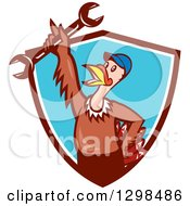 Clipart Of A Cartoon Turkey Bird Worker Mechanic Man Holding Up A Wrench In A Brown White And Blue Shield Royalty Free Vector Illustration