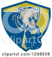 Clipart Of A Retro Woodcut Grizzly Bear With A Padlock In His Mouth Emerging From A Blue And Green Shield Royalty Free Vector Illustration