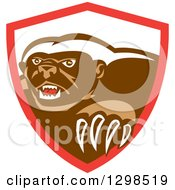 Clipart Of A Retro Honey Badger In A Red And White Shield Royalty Free Vector Illustration by patrimonio