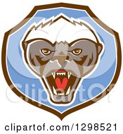 Clipart Of A Retro Angry Honey Badger In A Brown White And Blue Shield Royalty Free Vector Illustration by patrimonio