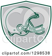 Clipart Of A Football Helmet In A Green White And Gray Shield Royalty Free Vector Illustration
