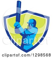 Clipart Of A Retro Cricket Batsman Emerging From A Blue White And Green Shield Royalty Free Vector Illustration
