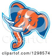 Clipart Of A Retro Woodcut Angry Elephant Head In Blue White And Orange Royalty Free Vector Illustration
