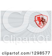 Clipart Of A Retro Woodcut Male Cameraman And Gray Rays Background Or Business Card Design Royalty Free Illustration