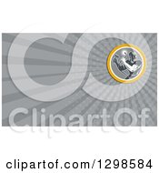 Clipart Of A Retro Welder And Gray Rays Background Or Business Card Design Royalty Free Illustration