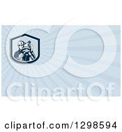 Clipart Of A Retro Male Surveyor And Blue Rays Background Or Business Card Design Royalty Free Illustration by patrimonio