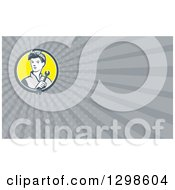 Clipart Of A Retro Female Mechanic Holding A Wrench And Gray Rays Background Or Business Card Design Royalty Free Illustration