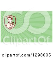 Clipart Of A Retro Female Mechanic Holding A Wrench And Green Rays Background Or Business Card Design Royalty Free Illustration