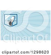 Clipart Of A Retro Window Washer Using A Squeegee And Blue Rays Background Or Business Card Design Royalty Free Illustration