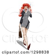 Beautiful Red Haired White Business Woman In A Skirt Walking And Talking On A Cell Phone