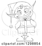 Clipart Of A Lineart Black And White Grinning Male Christmas Elf Holding A Gift Royalty Free Vector Illustration by Liron Peer