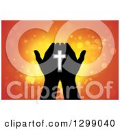 Clipart Of Silhouetted Hands Holding A Cross With Glowing Orange Lights Royalty Free Vector Illustration by ColorMagic