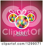 Clipart Of Pyramid Patterned Baubles Suspended Over Pink With Merry Christmas Text Royalty Free Vector Illustration