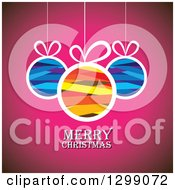 Clipart Of Ribbon Patterned Baubles Suspended Over Pink With Merry Christmas Text Royalty Free Vector Illustration