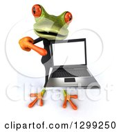 Clipart Of A 3d Formal Green Business Springer Frog Holding Up And Pointing To A Laptop Computer Royalty Free Illustration