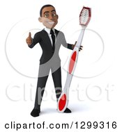 Clipart Of A 3d Young Black Businessman Or Dentist In A Suit Giving A Thumb Up And Holding A Giant Tootbrush Royalty Free Illustration