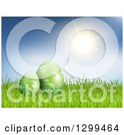 Clipart Of 3d Green Vine Patterned Easter Eggs In Grass Over A Blue Sky With Sunshie Royalty Free Vector Illustration by KJ Pargeter