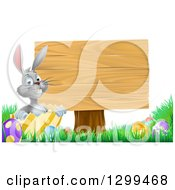 Clipart Of A Gray Easter Bunny Rabbit With Eggs Sitting In A Shell By A Blank Wood Sign Royalty Free Vector Illustration