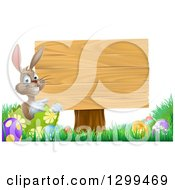 Clipart Of A Brown Easter Bunny Rabbit With Eggs Pointing To A Blank Wood Sign Royalty Free Vector Illustration