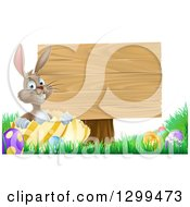 Clipart Of A Brown Easter Bunny Rabbit With Eggs Sitting In A Shell By A Blank Wood Sign Royalty Free Vector Illustration