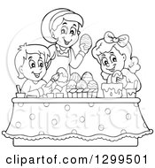 Clipart Of A Black And White Mom And Children Decorating Easter Eggs Royalty Free Vector Illustration