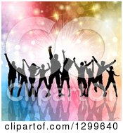 Clipart Of A Silhouetted Dancing And Cheering Crowd Over Colorful Bursts Flares And Lights Royalty Free Vector Illustration