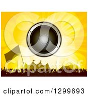 Music Speaker Over A Silhouetted Dancing Crowd Flag And Carnival Tents