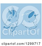 Clipart Of Cat And Dog Faces In Profile Over Blue Royalty Free Vector Illustration