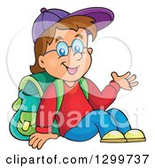 Clipart Of A Cartoon Brunette White School Boy Sitting And Presenting Royalty Free Vector Illustration by visekart