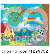 Gray Bunny Rabbit Resting In A Park With A Spring Rainbow And Butterflies