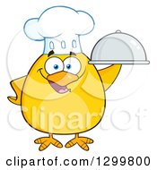 Clipart Of A Cartoon Yellow Chick Chef Holding A Cloche Platter Royalty Free Vector Illustration
