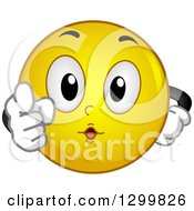 Clipart Of A Cartoon Yellow Smiley Face Emoticon Pointing Outwards Royalty Free Vector Illustration