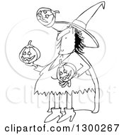 Clipart Of A Cartoon Black And White Witch Juggling Halloween Jackolantern Pumpkins Royalty Free Vector Illustration