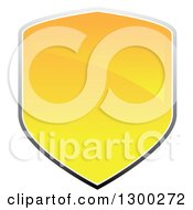 Clipart Of A 3d Shiny Yellow And Gray Shield Design Royalty Free Vector Illustration