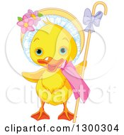 Clipart Of A Cute Yellow Easter Duck With A Bonnet And Cane Royalty Free Vector Illustration