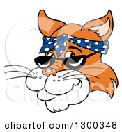 Clipart Of A Ginger Cat Face Wearing Sunglasses And A Bandana Royalty Free Vector Illustration
