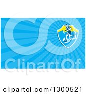 Clipart Of A Retro Woodcut Male Cross Country Runner Over Mountains And Blue Rays Background Or Business Card Design Royalty Free Illustration